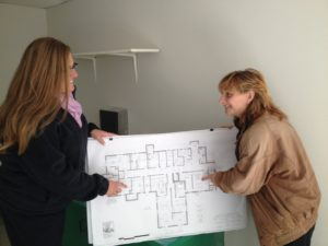 Rep. Ruggiero with Jennifer Barrera reviewing blueprint of Lucy's Hearth new location on Valley Street in Middletown